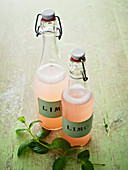 Bottles of rhubarb lemonade with mint