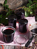 Homemade elderberry jelly in glass jars