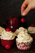 Decorating White Chocolate Cupcakes with Maraschino Cherries