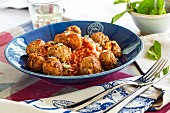 Lamb meatballs with tomato sauce, rice and mint