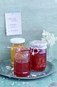 Fruit jam and elderflowers in glass jars