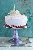 A cake with vanilla cream frosting and elderflowers