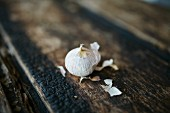 A mini bulb of garlic on a wooden background