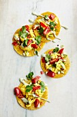 Tacos with scrambled egg, tomato and coriander