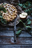 Vegan apple crumble cake on a rustic wooden background