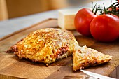A potato rosti filled with minced beef, cheese and tomatoes