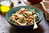 Grain salad with barley, artichoke and oven-roasted tomatoes