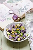 Violet gnocchi with courgette and mint