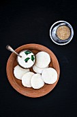 Idli (steamed rice cakes from India) with coconut chutney