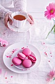 Pink macarons and a cup of tea