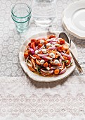 Tomato and mozzarella salad with onion