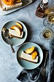 Gluten-free cheesecake with peaches in elderflower syrup