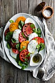 Caprese salad with red and yellow tomatoes (Italy)