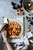 A galette with peach, nectarine and plum being made