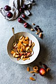 Peach, nectarine and plum wedges in a bowl