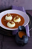Rosehip and seabuckthorn soup with walnut and semolina dumplings