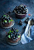 Small chocolate cakes with blackcurrants and mint