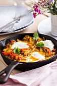 Middle Eastern shakshuka (baked eggs, peppers and tomatoes) with gochujang