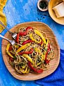 Spaghetti peperonata with chopped parsley and parmesan (Italy)