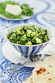 Spinach paneer in a blue and white dish