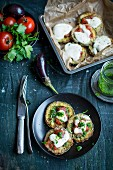 Aubergine pizza with tomatoes, parsley and pesto