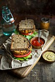 Vegan patty sandwiches with tomato, lettuce, mustard and ketchup