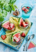 Watermelon with strawberries, almonds and honey