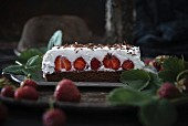 Vegan chocolate cake with strawberries and cream