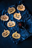 Sweet potato pumpkins with black and red ketchup for Halloween