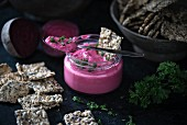Vegan beetroot and cashew spread with seed crackers