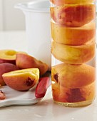 Peaches preserved in a glass