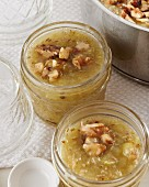 Gooseberry jam with walnuts in glass jars