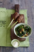 Stinging nettle spinach with pine nuts served with kofta meatballs