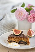 A slice of turmeric and orange cake with fig