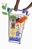 Hands pushing a shopping trolley full of pharmaceutical products