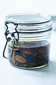 Preserved comfrey roots in a glass jar