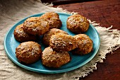 Carrot and spice cookies on a turquoise plate
