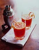 Cocktails garnished with orange peel