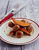 Meatballs with sweet potato wedges and dip