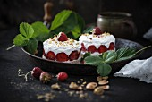 Vegan strawberry cakes with whipped soya cream and pistachios