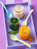Baby food made of spinach, carrots and oats