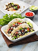 Black bean tacos with tomato, coriander and lime