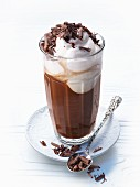 Hot chocolate in a glass with cream and chocolate shavings