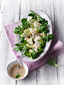 Honeydew melon salad on lamb's lettuce with a coconut dressing