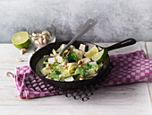 Savoy cabbage and tofu with coconut milk and cashew nuts