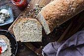 A sliced loaf of homemade wholegrain bread