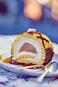A slice of chocolate Swiss roll