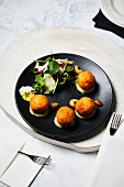 Arancini with lettuce and parmesan