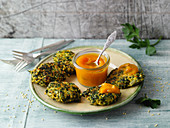 Spinach and millet fritters with pumpkin and turmeric ketchup