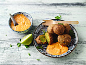Pea and turmeric falafel with pepper hummus